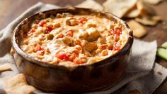 Cheesy Chicken Buffalo Dip: Chicken and buffalo wing sauce come together in this cheesy dip version of your favorite game-day dish. Score!