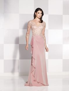 Two-tone chiffon and lace gown with illusion three-quarter length sleeves, lace bodice features front and back V-necklines, side draped skirt with cascading ruffle and sweep train, suitable for the mother of the bride and the mother of the groom. Jeweled Occasions earring style London sold separately. Sizes: 4 – 20