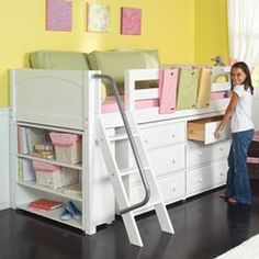 great idea for small bedroom - dresser and storage under a loft-style bed. Not as high up as a bunk bed- I like it!.