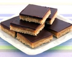 Creamy delicious caramel slice can be made from this simple recipe using condensed milk and melted chocolate. It's perfect for cake stalls and fetes too.