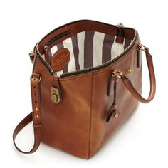 Westward Adventurer Satchel, Kate Spade. This satchel evokes long train rides and mysterious doings.