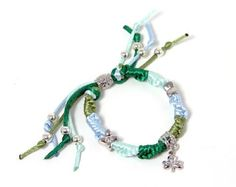Woven Friendship Bracelet w/ Lucky Irish Shamrock Bead  Price : $14.17 http://www.biddymurphy.com/Woven-Friendship-Bracelet-Lucky-Shamrock/dp/B00CUDZHF8