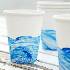 Nautical party - Captain's Table: Wave Cups  Dip a sponge in blue paint and swipe around the cup to create a wave pattern