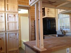 8′ x 24′ Cute Green Tiny House on Wheels -- many great storage ideas and woodworking details!