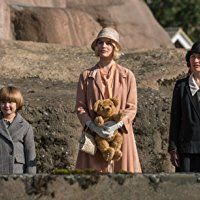 Kelly Macdonald, Margot Robbie, and Will Tilston in Goodbye Christopher Robin (2017)