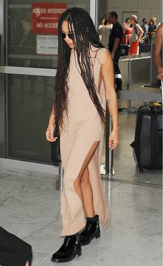 Zoë Kravitz in a nude maxi dress and black boots