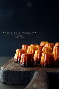 Canelés de Bordeaux is a speciality of Bordeaux, France and traditionally sold in batches of 8 or They are a small pastry with soft custard centre and a dark, thick caramelised crust. (image via Chili & Tonka) Just Desserts, Dessert Recipes, Small Desserts, Good Food, Yummy Food, Food Inspiration, Sweet Recipes, The Best, Cravings
