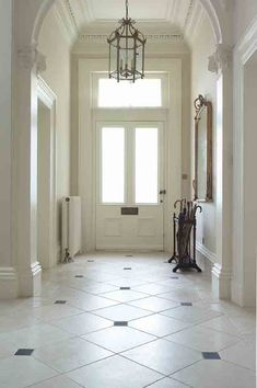 Aged Cream Hallway Floor with Aged Black Cabochans Foyer Flooring, Limestone Flooring, Natural Stone Flooring, Kitchen Flooring, Travertine, Entry Tile, Tiled Hallway, Entry Foyer, Cream Tile Floor