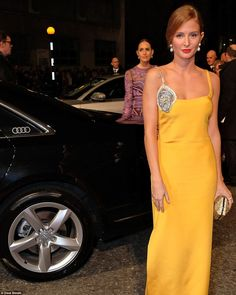 Out and a pout: Millie sizzled as she posed into the camera while heading into the bash in her silk gown