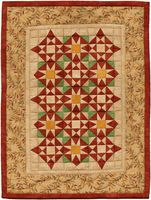 10,677 - Autumn Meadow  --Two star blocks combine to make this lovely AAQI mini from Martha Wolfersberger