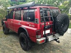 Nissan patrol rear door ladder by Overbuilt Accessories Best 4x4 Cars, Best Suv, Off Road Truck Accessories, Patrol Gr, Nissan Terrano, Nissan 4x4, 2019 Ford Explorer, Suv Comparison, Suv 4x4