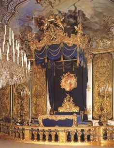 Linderhof Castle..Kings bed chamber. The bed is 2 meters by 2.5 meters wide.  A giant sized bed for a large-than-life King. Ludwig liked ornate drapes in his bedroom.