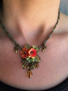 Necklace with beaded flowers in resin and beads Orange green and beige Crackle glass mounted on silver plated chain