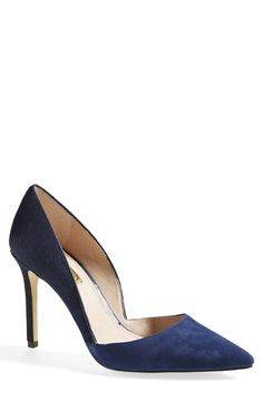 A sophisticated d'Orsay pump with contrasting textures is heightened with a slender heel. Love the two textures and great color