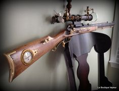 Handmade steampunk rifle made from vintage and antique recycled 1800s surveyor scope brass parts with victorian charm