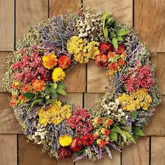 At farmers' markets across America, artisans showcase local botanicals by creating decorative wreaths. Hand-made on a family-owned farm, our wreath celebrates this tradition with a medley of colorful dried flowers and fragrant herbs. Blue lavender, purple Mexican sage and creamy achilla of the pearl mingle with golden yarrow and orange safflowers. A backdrop of aromatic greenery includes marjoram, thyme, sage and fresh bay leaves along with delicate pepperberries. All herbs are grown without…