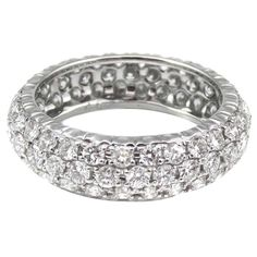 Diamond Gold Eternity Band Ring | From a unique collection of vintage band rings at https://www.1stdibs.com/jewelry/rings/band-rings/