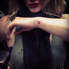 'All is full of love...' Hilary Duff posts a photo on Instagram of her new heart tattoo on March 17, 2013.