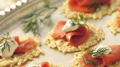"""Make """"crackers"""" out of snappy Parmesan, a spirited base for flavorful cured salmon and crème fraîche."""