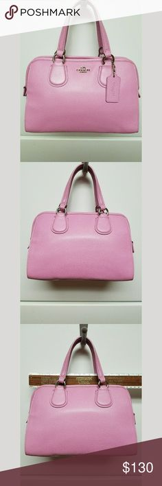 Coach mini nolita satchel Coach mini nolita satchel. Color is called marshmallow. Bag is almost in perfect condition.  Has one tiny transfer mark on the front that isn't noticible unless you are trying to find it. Has never been used,  I did lose the tags though Coach Bags Satchels