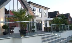 Glass Balustrade Solutions That Architects Need - Glass Balcony Systems Patio Balustrade Ideas, Outdoor Handrail, Decking Glass Balustrade, Decking Panels, Back Garden Design, Modern Garden Design, Modern Patio, Patio Deck Designs, Patio Design