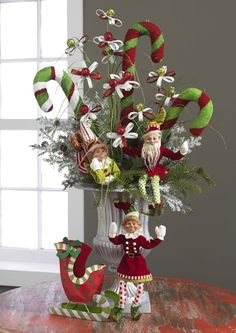Christmas Arrangement with candy canes and elves