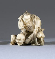 "IVORY NETSUKE Meiji Period Depicting two wrestlers. Signed ""Toshikazu"". Length 1.75"" (4.5 cm)."