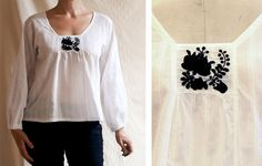 black-on-white interpretation of Matyó-style Hungarian embroidery on striped voile blouse