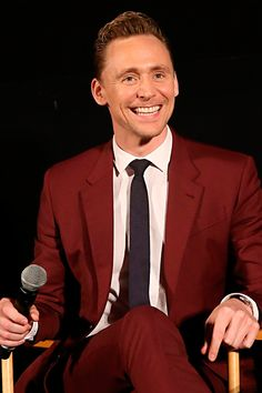 """Tom Hiddleston Stirs Up Tailored Style Envy. """"On the road promoting The Night Manager, English actor Tom Hiddleston is having quite the style tour. Following a series of standout suits, Hiddleston is back with more enviable tailored ensembles. Making a relatable but bold style move, Hiddleston was in a jovial mood as he sat down for a screening in a deep red Paul Smith suit."""" Link: http://www.thefashionisto.com/tom-hiddleston-2016-style-night-manager-press-tour/"""
