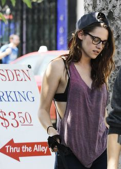 Kristen Stewart famous for being in tomboy styled casual clothes. Love her top!!