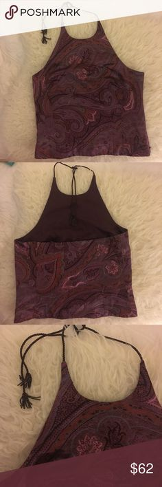 Paisley patterned halter w/ beaded tassel strap Soft Satin material. Dark purple swirled paisley pattern. Zipper on the side. Halter straps has beautiful beaded detail. Gorgeous top that can be worn with many different things. Have worn with jeans & also with a full skirt to a wedding. Ann Taylor Tops Blouses