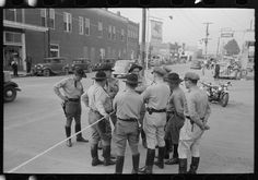 State troopers at National Rice Festival, Crowley, Louisiana.   Photographer  Russell Lee.   Created  October 1938