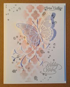 "By Patsy Collins. Sponge through only part of a stencil. (I used ""Lattice"" by Heidi Swapp/Pink Paislee.) Stamp sentiment. Add splotches (stamp from ""French Foliage"" by Stampin' Up). Add die-cuts. (I used ""Vivienne Butterfly"" and ""Flutter Vine,"" both by Memory Box.)"