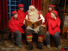 Santa Claus and the elves in Santa Claus Office in Rovaniemi in Lapland