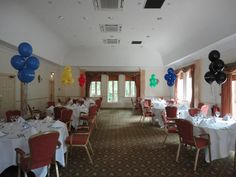 Bouquets of coloured balloons to match team colours on a Corporate Golf Day