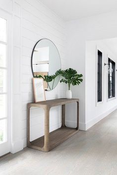 Scroll on for a few of our favorite shiplap hallway ideas that will have you hauling wooden slats home before you know it. #hunkerhome #shiplap #hallwayideas #hallwayshiplap #shiplapideas Entry Stairs, Entry Wall, Front Hallway, Hallway Inspiration, Hallway Ideas, Small Entry Tables, Small Entrance, Shiplap Paneling, Aqua Walls