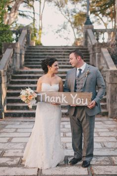 Thank you sign with bride and groom