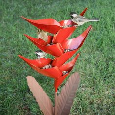 Heliconia Bird Feeder in lawn, with three birds perched from Desert Steel Metal Garden Art, Metal Art, Mosaic Garden, Dubai Miracle Garden, How To Attract Birds, Humming Bird Feeders, Bird Perch, Outdoor Art, Outdoor Ideas