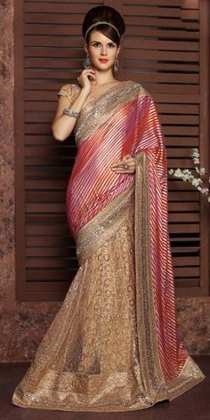 Delightful Pink Net Saree With Blouse.