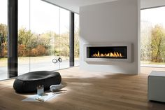 Marquis Infinite Gas Fireplace: The Marquis Infinite gives you a sleek, stylish stretch of dancing flames. This contemporary zero-clearance design includes accent lighting with a decorative ember glass bed and SIT valve for easy adjustment.