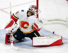 Calgary Flames goaltender Mike Smith (41) looks back at the puck as it bounces in on a shot from Carolina Hurricanes' Brock McGinn (23) during the third period of an NHL hockey game, Sunday, Jan. 14, 2018, in Raleigh, N.C. (AP Photo/Karl B DeBlaker)