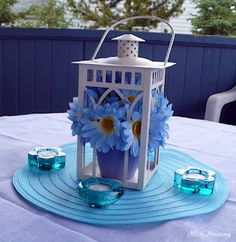 DIY blue daisy centerpiece using a Pier 1 White Cathedral Lantern