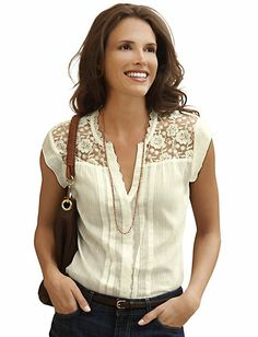 Eddie Bauer. I have this shirt, but bought a size too small. (Eddie Bauer's sizes are always tough to figure out for me! I think something fits, I wash it, and the fit changes!) I absolutely loved it. Feminine and gentle look.
