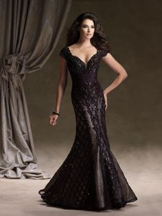 Ivonne D Exclusively for Mon Cheri - 113D05 - Lace and taffeta mermaid gown with scattered hand-beading, cap sleeves, deep V-neckline with attached beaded modesty piece, open back bodice, ruched taffeta empire waistline. Matching shawl included.Sizes: 4 – 20Colors: Black/Nude