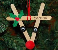 Craft a reindeer Christmas ornament from popsicle sticks- also for our classroom tree