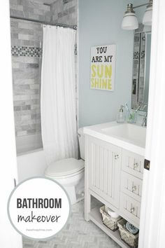 I love the look of the white shower curtain in the bathroom.