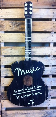 """Music is not what I do, it's who I am real solid wood guitar sign. This sign is the dimensions of a full sized 40"""" acoustic guitar.   Handmade and hand painted. Custom colors are available upon request. 