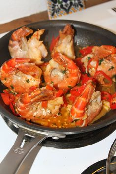 Prawns with just-picked fresh chili peppers, garlic, cilantro lime... after you cool and peel shells off, drizzle with a tad of honey... mmmm #spicyfood #yum