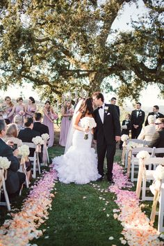Line the aisle with ombre rows of flower petals for extra magic on your wedding day | Diana Lupu Photography