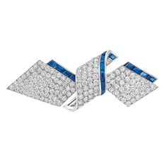Platinum, Diamond and Sapphire Ribbon Brooch   The looped ribbon pave-set with 164 round diamonds approximately 5.50 cts., edged by 20 rectangular-cut sapphires, circa 1935